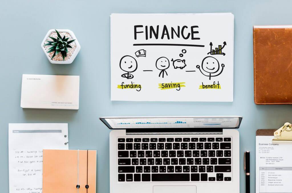 finance sketch near laptop computer